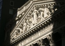 The New York Stock Exchange is shown, Tuesday, July 21, 2020. Stocks are holding on to their gains, Wednesday, July 29, on Wall Street after the Federal Reserve said it will keep the accelerator floored on its aid for the economy. (AP Photo/Mark Lennihan)