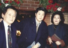 In this undated photo provided by Charlton Rhee, Rhee, a nursing home administrator from New York, poses for a photo with his parents, Man Joon Rhee and Eulja Rhee. Charlton Rhee, whose parents came to the U.S. from South Korea, lost both of them to COVID-19 as the virus surged in New York City. A joint analysis by The Associated Press and The Marshall Project found that Asian Americans join Black and Hispanic Americans among the hardest-hit groups, with deaths in each group up at least 30% this year. (Courtesy of Charlton Rhee via AP)