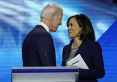 FILE - In this Sept. 12, 2019, file photo, Democratic presidential candidate former Vice President Joe Biden, left, and then-candidate Sen. Kamala Harris, D-Calif. shake hands after a Democratic presidential primary debate hosted by ABC at Texas Southern University in Houston. Biden has chosen Harris as his running mate. (AP Photo/David J. Phillip, File)