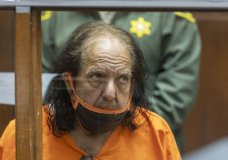 FILE - Adult film star Ron Jeremy appears for his arraignment on rape and sexual assault charges at Clara Shortridge Foltz Criminal Justice Center, on June 26, 2020, in Los Angeles. Jeremy has been charged with 20 new counts of rape or sexual assault involving 12 women and a teenage girl. Authorities say the new counts were filed Monday, Aug. 31. (David McNew/Pool Photo via AP, File)