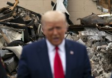 President Donald Trump speaks as he tours an area Tuesday, Sept. 1, 2020, that was damaged during demonstrations after a police officer shot Jacob Blake in Kenosha, Wis. (AP Photo/Evan Vucci)