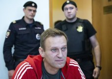 "FILE In this file photo taken on Thursday, Aug. 22, 2019, Russian opposition leader Alexei Navalny speaks to the media prior to a court session in Moscow, Russia. German Chancellor Angela Merkel says Russian opposition leader Alexei Navalny was the victim of an ""attempted murder by poisoning"" and the aim was to silence him. Navalny was poisoned with the same type of Soviet-era nerve agent that British authorities identified in a 2018 attack on a former Russian spy, the German government said Wednesday, Sept. 2, 2020 citing new test results. (AP Photo/Alexander Zemlianichenko, File)"