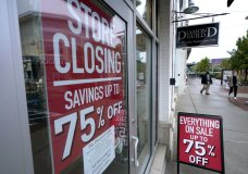 Passersby walk past a business storefront with store closing and sale signs, Wednesday, Sept. 2, 2020, in Dedham, Mass. The number of people seeking U.S. unemployment aid rose slightly to 870,000, a historically high figure that shows that the viral pandemic is still squeezing restaurants, airlines, hotels and many other businesses six months after it first erupted. (AP Photo/Steven Senne)