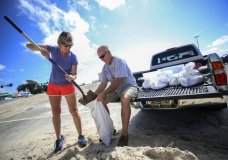 Kim Miller and Monty Graham open their truck bed and began loading up sandbags along U.S. 90 in preparation for Tropical Storm Sally, Sunday, Sept. 13, 2020 in Gulfport, Miss. (Alyssa Newton/The Sun Herald via AP)