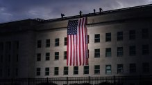 A large American flag is unfurled at the Pentagon ahead of ceremonies at the National 9/11 Pentagon Memorial to honor the 184 people killed in the 2001 terrorist attack on the Pentagon, in Washington, Friday Sept. 11, 2020. (AP Photo/J. Scott Applewhite)