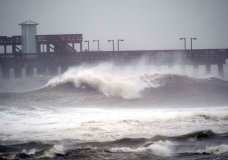 Waves crash near a pier, at Gulf State Park, Tuesday, Sept. 15, 2020, in Gulf Shores, Ala. Hurricane Sally is crawling toward the northern Gulf Coast at just 2 mph, a pace that's enabling the storm to gather huge amounts of water to eventually dump on land. (AP Photo/Gerald Herbrt)