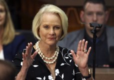 FILE - In this Jan. 13, 2020, file photo Cindy McCain, wife of former Arizona Sen. John McCain, waves to the crowd after being acknowledged by Arizona Republican Gov. Doug Ducey during his State of the State address on the opening day of the legislative session at the Capitol in Phoenix. Cindy McCain is going to bat for Joe Biden, lending her voice to a video set to air on Tuesday, Aug. 18, during the Democratic National Convention programming focused on Biden's close friendship with her late husband, Sen. John McCain. (AP Photo/Ross D. Franklin, File)