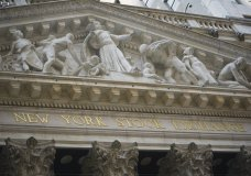 FILE - Marble sculptures occupy the pediment above the New York Stock Exchange signage, Tuesday Aug. 25, 2020, in New York. Stocks are falling again on Wall Street Friday, Sept. 4, a day after a big slump in technology companies pulled the market to its biggest drop since June. (AP Photo/Bebeto Matthews, File)