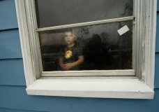 CORRECTS TO HUNTER FONTENOT NOT HUNTER DANIEL - Hunter Fontenot, 3, looks out the window of his uncle's house, to which his family temporarily relocated to ride out Hurricane Delta which is expected to make landfall later in the day, in Lake Charles, La., Friday, Oct. 9, 2020. (AP Photo/Gerald Herbert)