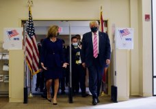 President Donald Trump walks with Wendy Sartory Link, Supervisor of Elections Palm Beach County, after casting his ballot for the presidential election, Saturday, Oct. 24, 2020, in West Palm Beach, Fla. (AP Photo/Evan Vucci)
