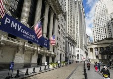 FILE - Pedestrians pass the New York Stock Exchange, Friday, Oct. 2, 2020, in New York. U.S. stocks are drifting on Thursday, Oct. 22, as more big companies report profits for the summer that were better than Wall Street feared. (AP Photo/John Minchillo)