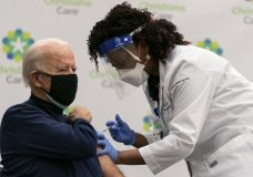 President-elect Joe Biden receives his first dose of the coronavirus vaccine from Nurse partitioner Tabe Mase at Christiana Hospital in Newark Del., Monday, Dec. 21, 2020, from nurse practitioner Tabe Mase. (AP Photo/Carolyn Kaster)