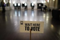 A sign is displayed for voters to guide the way at a precinct during Georgia's Senate runoff elections on Tuesday, Jan. 5, 2021, in Atlanta. (AP Photo/Brynn Anderson)