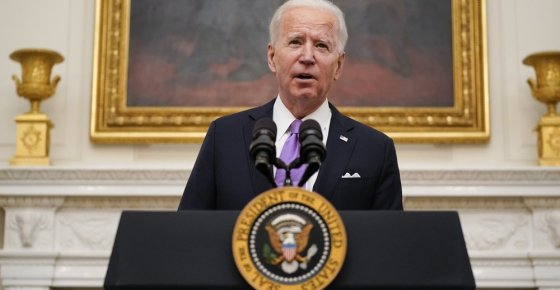 President Joe Biden speaks about the coronavirus in the State Dinning Room of the White House, Thursday, Jan. 21, 2021, in Washington. (AP Photo/Alex Brandon)