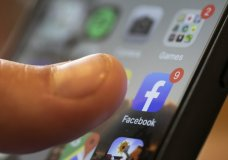 FILE - In this Aug. 11, 2019, file photo, an iPhone displays the Facebook app in New Orleans. Users across the northeast U.S. reported widespread internet outages Tuesday, Jan. 26, 2021. Verizon reported a fiber cut in Brooklyn via Twitter, although it's not clear if that issue is responsible for the entire outage. According to DownDetector and user reports on Twitter, the problem appears to extend from Washington to Boston, and is affecting internet and cloud providers as well as a number of Google services, Facebook and other major sites. (AP Photo/Jenny Kane, File)