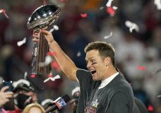 Tampa Bay Buccaneers quarterback Tom Brady celebrates with the Vince Lombardi Trophy after the NFL Super Bowl 55 football game against the Kansas City Chiefs Sunday, Feb. 7, 2021, in Tampa, Fla. The Buccaneers defeated the Chiefs 31-9 to win the Super Bowl. (AP Photo/Lynne Sladky)