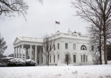 In this Feb. 1, 2021, photo, snow covers the ground at the White House in Washington. Only a fragment of Americans believe democracy is thriving in the U.S., even as broad majorities agree that representative government is one of the country's bedrock principles, according to a new poll from The Associated Press-NORC Center for Public Affairs Research. Just 16% of Americans say democracy is working well or extremely well, a pessimism that spans the political spectrum. (AP Photo/Evan Vucci)