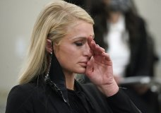 Paris Hilton wipes her eyes after speaking at a committee hearing at the Utah State Capitol, Monday, Feb. 8, 2021, in Salt Lake City. Hilton has been speaking out about abuse she says she suffered at a boarding school in Utah in the 1990s and she testified in front of state lawmakers weighing new regulations for the industry. (AP Photo/Rick Bowmer)