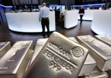 FILE - In this file photo dated Wednesday, May 9, 2007, Silver bullion, bars weighing five kilograms each, are displayed in the trading room of the stock exchange in Frankfurt, Germany. Silver futures jumped more than 10% on Monday Feb. 1, 2021, following strong gains over the weekend.(AP Photo/Michael Probst, FILE)