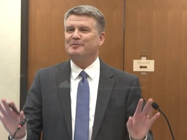 In this image from video, Assistant Minnesota Attorney General Matthew Frank, questions witness Jena Scurry as Hennepin County Judge Peter Cahill presides Monday, March 29, 2021, in the trial of former Minneapolis police officer Derek Chauvin, in the May 25, 2020, death of George Floyd at the Hennepin County Courthouse in Minneapolis, Minn. (Court TV via AP, Pool)