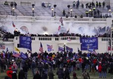 "FILE - In this Wednesday, Jan. 6, 2021, file photo, rioters storm the Capitol, in Washington. Capitol Police say they have intelligence showing a ""possible plot"" by a militia group to breach the U.S. Capitol on Thursday, nearly two months after a mob of supporters of then-President Donald Trump stormed the iconic building to try to stop Congress from certifying now-President Joe Biden's victory. The threat appears to be connected to a far-right conspiracy theory, mainly promoted by supporters of QAnon, that Trump will rise again to power on March 4. That was the original presidential inauguration day until 1933, when it was moved to Jan. 20. (AP Photo/John Minchillo, File)"