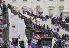 FILE - In this Jan. 6, 2021 file photo insurrectionists loyal to President Donald Trump riot outside the Capitol in Washington. (AP Photo/John Minchillo, File)