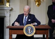 FILE - In this Jan. 27, 2021 file photo, President Joe Biden signs an executive order on climate ...