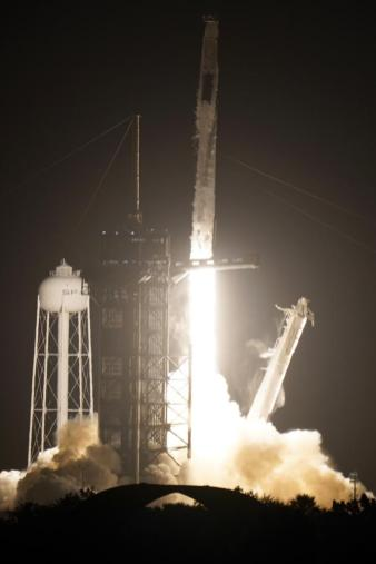 A SpaceX Falcon 9 rocket with the Crew Dragon space capsule lifts off from pad 39A at the Kennedy Space Center in Cape Canaveral, Fla., Friday, April 23, 2021. (AP Photo/Brynn Anderson)