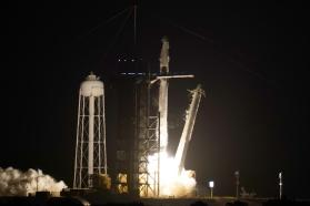 A SpaceX Falcon 9 rocket with the Crew Dragon space capsule lifts off from pad 39A at the Kennedy Space Center in Cape Canaveral, Fla., Friday, April 23, 2021. (AP Photo/John Raoux)