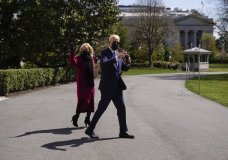 President Joe Biden and first lady Jill Biden walk to board Marine One on the South Lawn of the White House in Washington, Friday, April 2, 2021, to travel to Camp David, Md. (AP Photo/Andrew Harnik)