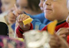 FILE - In this Monday, Oct. 29, 2018, file photo, kids eat lunch at an elementary school in Paducah, Ky. The Biden administration is expanding a program to feed as many as 34 million school children during the summer months. They're using funds from the coronavirus relief package approved in March 2021. (Ellen O'Nan/The Paducah Sun via AP, File)