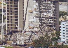 Crews work in the rubble at the Champlain Towers South Condo, Sunday, June 27, 2021, in Surfside, Fla. One hundred fifty-nine people were still unaccounted for two days after Thursday's collapse. (AP Photo/Gerald Herbert)