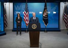 Vice President Kamala Harris listens as President Joe Biden speaks about the COVID-19 vaccination program, in the South Court Auditorium on the White House campus, Wednesday, June 2, 2021, in Washington. (AP Photo/Evan Vucci)