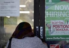 A shopper enters a retail store as a hiring sign shows in Buffalo Grove, Ill., Thursday, June 24, 2021. America's employers added 850,000 jobs in June, well above the average of the previous three months and a sign that companies may be having an easier time finding enough workers to fill open jobs. (AP Photo/Nam Y. Huh)