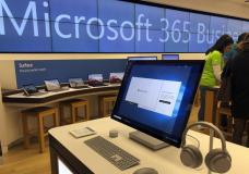 FILE - In this Jan. 28, 2020, file photo, a Microsoft computer is among items displayed at a Microsoft store in suburban Boston. The Biden administration on Monday, July 19, 2021, blamed China for a hack of Microsoft Exchange email server software that compromised tens of thousands of computers around the world earlier in the year. (AP Photo/Steven Senne, File