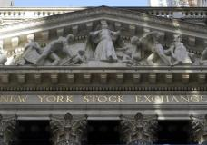 FILE - The facade of the New York Stock Exchange, is seen Wednesday, June 16, 2021. Stocks are wobbling between small gains and losses in the early going on Wall Street, keeping major indexes close to the record highs they set last week. The S&P 500 and the Dow Jones Industrial Average were little changed in the early going Monday, July 26. (AP Photo/Richard Drew, File)