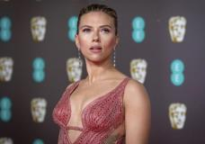 """FILE - Scarlett Johansson arrives at the Bafta Film Awards, in central London, Feb. 2 2020. Johansson is suing the Walt Disney Co. over the company's streaming release of """"Black Widow,"""" which she said breached her contract and deprived her of potential earnings. The """"Black Widow"""" star and executive producer filed a suit Thursday, July 29, 2021, in the Los Angeles Superior Court that said her contract guaranteed an exclusive theatrical release. (Photo by Vianney Le Caer/Invision/AP, File)"""