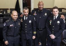 In this July 27, 2021 photo, from left, U.S. Capitol Police Sgt. Aquilino Gonell, Washington Metropolitan Police Department officer Michael Fanone, U.S. Capitol Police Sgt. Harry Dunn and Washington Metropolitan Police Department officer Daniel Hodges pose for a photo after a House select committee hearing on the Jan. 6 attack on Capitol Hill in Washington. The Senate has voted to award Medals of Honor to the Capitol Police and the Metropolitan Police Department for protecting Congress during the Jan. 6 insurrection, sending the legislation to President Joe Biden for his signature.  The bill passed by voice vote with no objections. The four medals will be displayed at Capitol Police headquarters, the Metropolitan Police Department, the U.S. Capitol and the Smithsonian Institution. (Oliver Contreras/The New York Times via AP, Pool)