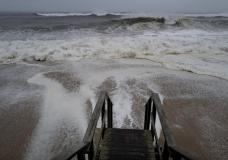 Waves pound the beaches of Montauk, N.Y., Sunday, Aug. 22, 2021, as a severe weather system approaches. (AP Photo/Craig Ruttle)