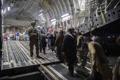 In this Aug. 22, 2021, photo provided by the U.S. Air Force, Afghan passengers board a U.S. Air Force C-17 Globemaster III during the Afghanistan evacuation at Hamid Karzai International Airport in Kabul, Afghanistan. (MSgt. Donald R. Allen/U.S. Air Force via AP)