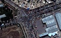 This satellite image provided by Maxar Technologies shows crowds and traffic at the entrance to Kabul's international airport on Monday, Aug. 23, 2021. (Satellite Image ©2021 Maxar Technologies via AP)