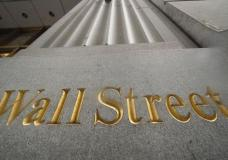 FILE - In this Nov. 5, 2020 file photo, a sign for Wall Street is carved in the side of a building, in New York. Stocks are opening slightly lower on Wall Street Wednesday, Aug, 18, 2021, a day after the S&P 500 had its biggest drop in four weeks and broke a five-day winning streak. (AP Photo/Mark Lennihan, File)