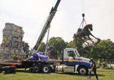 Crews move the horse of Confederate General Robert E. Lee one of the country's largest remaining monuments to the Confederacy, on Monument Avenue in Richmond, Va., Wednesday, Sept. 8, 2021. (AP Photo/Steve Helber)
