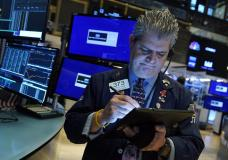Trader John Panin works on the floor of the New York Stock Exchange, Thursday, Sept. 9, 2021. Stocks were slightly higher Thursday morning on Wall Street as the market continues to wobble between gains and losses in this holiday-shortened week. (AP Photo/Richard Drew)