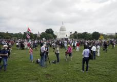 """People attend a rally near the U.S. Capitol in Washington, Saturday, Sept. 18, 2021. The rally was planned by allies of former President Donald Trump and aimed at supporting the so-called """"political prisoners"""" of the Jan. 6 insurrection at the U.S. Capitol. (AP Photo/Jose Luis Magana)"""