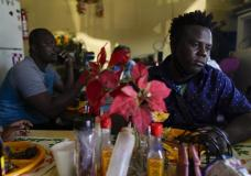 Robins Exile, of Haiti, eats at a Haitian restaurant, Monday, Sept. 20, 2021, in Tijuana, Mexico. Exile arrived to Tijuana a day earlier after changing his plans to head to the Texas border where thousands of Haitians have converged in recent days and now face deportation. He said messages on WhatsApp and Facebook from fellow Haitian migrants and their videos on YouTube warned him to steer clear of Ciudad Acuna, Mexico, across from Del Rio, Texas, and said it no longer is the easy place to cross into the U.S. that it was just a few weeks ago. (AP Photo/Gregory Bull)