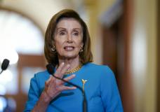 Speaker of the House Nancy Pelosi, D-Calif., talks to reporters as she welcomes Australian Prime Minister Scott Morrison, at the Capitol in Washington, Wednesday, Sept. 22, 2021. The House has approved legislation to fund the government, suspend its borrowing limit and provide federal disaster and refugee aid but Republicans in the Senate are expected to block the measure.(AP Photo/J. Scott Applewhite)