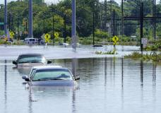 Vehicles are under water during flooding in Norristown, Pa. Thursday, Sept. 2, 2021 in the aftermath of downpours and high winds from the remnants of Hurricane Ida that hit the area. (AP Photo/Matt Rourke)