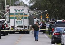 Polk County, Fla., Sheriff's officials work the scene of a multiple fatality shooting Sunday, Sept. 5, 2021, in Lakeland, Fla. Four people are dead including a mother who was still cradling her now deceased baby in what Florida sheriff's deputies are calling a massive gun battle with a suspect. (Michael Wilson/The Ledger via AP)