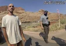 """FILE - This Aug. 12, 2021 file photo from video provided by the Moab, Utah, Police Department shows Brian Laundrie talking to a police officer after police pulled over the van he was traveling in with his girlfriend, Gabrielle """"Gabby"""" Petito, near the entrance to Arches National Park in Utah. The FBI on Thursday, Oct. 21, 2021, identified human remains found in a Florida nature preserve as those of Laundrie, a person of interest in the death of girlfriend Gabby Petito while the couple was on a cross-country road trip. (The Moab Police Department via AP, File)"""